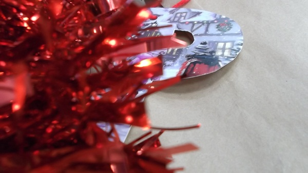 Our gift from the make do and menders complete with tinsel bow and recycled Christmas card label