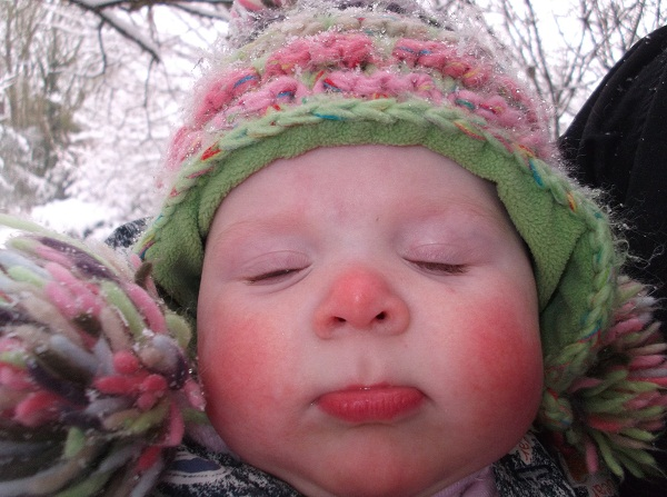 'I am closing my eyes as the snow keeps getting in them' Lizzie aged 8 months!