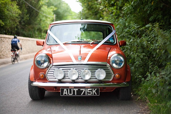 Our wedding car - our mate Ben's most beautiful mini - restored by his own fair hand! He even removed the passenger seat so that Becksie could climb in and out with ease! We chose a mini because they are extremely cute!