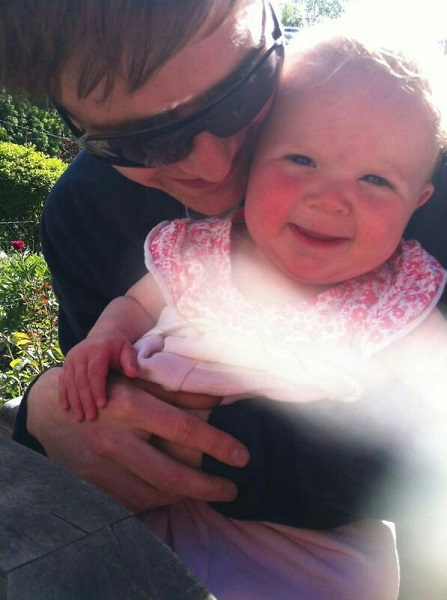 Uncle Liam and Lizzie playing in the garden