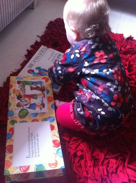Lizzie reading a few of Aunty Leah's old childhood books
