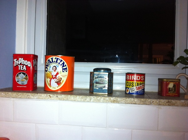 All of these tins found their way from charity shops to our window sill