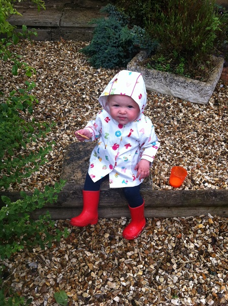 Lizzie 'enjoying' snack time in the rain whilst mummy was gardening!